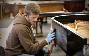Tim Chupp Polishing Piano - Expert Piano Refinishing